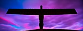 England, Tyne and Wear, Gateshead  The iconic Angel of the North statue by Antony Gormley, silhouetted against an atmospheric sky  The ´Angel´, built on a a former colliery pit head bath site, is one of the worlds most viewed work of art with over 33 mill