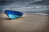 Small boat beached at Saundersfoot in South Wales, UK