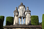 Statues of Queen Isabella, King Ferdinand and Christopher Columbus in the Alcazar gardens, Cordoba, Andalusia, Spain
