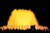 Tourists enjoying the light show of the Plaza de Espana in Barcelona, Catalonia, Spain
