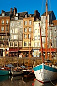 harbour scene with yaughts and harbour restaurants  Honfleur, Normandy, France