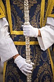 An acolyte holds a cross during an Easter Holy Week procession in Cordoba, Spain, April 18, 2011