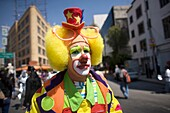 A clown walks in a parade during the 16th International Clown Convention: The Laughter Fair organized by the Latino Clown Brotherhood, in Mexico City, October 17, 2011
