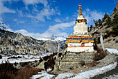 Nepal Annapurna ring Stupa under the snow on the way to MANANG