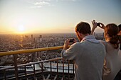 Japan,Tokyo,Roppongi,Tokyo City View Tower,Tourists Taking Photographs with Mobile Phones