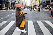 Japan,Tokyo,Ginza,Monk Collecting Alms