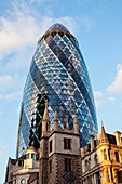 England,London,The City,The Gherkin and St.Andrew Undershaft Church