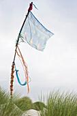 Flag and sand dunes near Nebel, Amrum, North Frisian Islands, Schleswig-Holstein, Germany