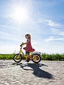 Girl cycling, Upper Bavaria, Germany