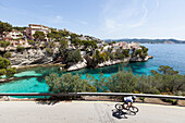 Bicycle rider at the Mediterranean coast, Peguera, Majorca, Balearic Islands, Spain