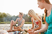 Young people barbecueing on the Isar riverbank, Munich, Bavaria, Germany