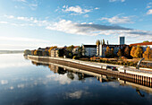 Oder river, houses and Oder Tower under clouded sky, Frankfurt/Oder, Land Brandenburg, Germany, Europe