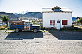 Old truck near a house, El Chalten, Fitz Roy in background, Santa Cruz, Patagonia, Argentina