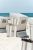 Hooded beach chair on the beach, Sylt, Schleswig-Holstein, Germany