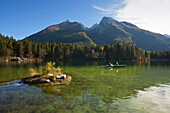 Rowing boat on lake Hintersee, view onto Hochkalter, Ramsau, Berchtesgaden region, Berchtesgaden National Park, Upper Bavaria, Germany, Europe