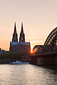 Cathedral and Hohenzollern bridge at sunset, Cologne, North Rhine-Westphalia, Germany, Europe