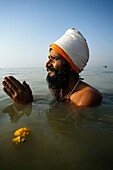 Pilgrim bathing at the confluence of the river Ganges and the Bay of Bengal , Sagar Mela, India, Ganges River