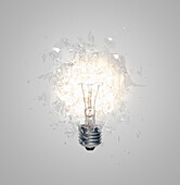 A Light Bulb shattering, exploding. Close up of light bulb shattering