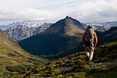 Patagonian Expedition Race, Chile, Karukinka National Preserve, trekking. Hiker walking in grassy hills