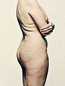 Nude beauty portrait of old woman