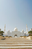 Steps leading to ornate domed mosque. Sheikh zayed bin sultan al nahyan mosque, abu dhabi