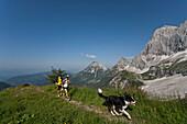 Trailrunning, Trail running, Trail, Ramsau, Dachstein, Styria, Austria, couple, woman, man, meadow, running, walking, run, jogging, sport, fitness, health, dog. Trailrunning, Trail running, Trail, Ramsau, Dachstein, Styria, Austria, couple, woman, man, me