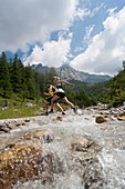 Trailrunning, Trail running, Trail, Ramsau, Dachstein, Styria, Austria, couple, woman, man, running, walking, run, mountains, brook, dog, water jogging, sport, fitness, health,. Trailrunning, Trail running, Trail, Ramsau, Dachstein, Styria, Austria, coupl