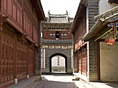 The Building Gate is delicate and profound  It has the smack of a palace or a pavilion in Central China with double eaves and raised corners  The upper part of the door frame, eaves plank and lintel are made of wood  The base of the Gate is made of bricks