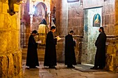 An Armenian Orthodox mass, Church of the Holy Sepulchre site of the last five stations of the Cross and venerated as the place where Jesus was crucified and buried, the Christian Quarter, Old City, Jerusalem, Israel