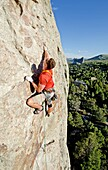 Elijah Weber rock climbing Scream Cheese which is rated 5,9 and located on the Anteater at The City Of Rocks National Reserve near the town of Almo in southern Idaho