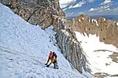 Mark Weber climbing The June Couloir on the North Face of Williams Peak high above the Sawtooth Valley in the Sawtooth Mountains near the town of Stanley in central Idaho