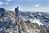 Elijah Weber on the summit after climbing The June Couloir on the North Face of Williams Peak high above the Sawtooth Valley in the Sawtooth Mountains near the town of Stanley in central Idaho