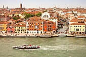 Panoramic view of buildings, rooftops, promenade and Giudecca Canal, Venice, Italy