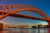 The Hell Gate and Triborough Robert F Kennedy bridges span the Hell Gate tidal strait in the East River from Randall´s/Wards Island to the borough of Queens in New York City, as the last hint of the setting sun fades into the western sky during evening tw