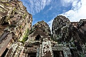 The Bayon Khmer: Prasat Bayon is a well-known and richly decorated Khmer temple at Angkor in Cambodia, Built in the late 12th century or early 13th century as the official state temple of the Mahayana Buddhist King Jayavarman VII, the Bayon stands at th