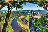 View from the spectacular rock formation Bastei Bastion to health resort Rathen and the Elbe River The Bastei is one of the most visited tourist attractions in the national park Saxon Switzerland In the background is the Table Mountain Lilienstein He is o