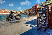 Restaurant advertising sign at the Venetian harbor in Chania, Crete, Greece