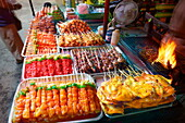 Thailand, Phuket Island, Patong Beach, street stall with meat skewers ready to grill
