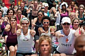 Thousands of yoga practitioners in Times Square in New York participate in a mid-day Bikram Yoga class on the first day of summer Temperatures are expected to rise into the upper 90´s today as most New Yorkers seek relief from the heat