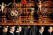 The wooden throne with fine carvings and sculptures is carried on the shoulders of the carriers during the Easter celebration in Malaga, Spain, 5 April 2007