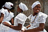 Baiana girls wait in the line before the ritual ceremony in honor to Yemanjá, the Candomblé goddess of the sea, in Cachoeira, Bahia, Brazil, 5 February 2012  Yemanjá, originally from the ancient Yoruba mythology, is one of the most popular 'orixás', the d