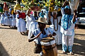 A young Candomblé follower plays drum during the ritual procession in honor to Yemanjá, the goddess of the sea, in Amoreiras, Bahia, Brazil, 3 February 2012  Yemanjá, originally from the ancient Yoruba mythology, is one of the most popular 'orixás', the d