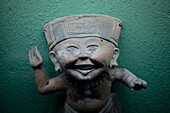 Sculpture of a smiling boy displayed at the Rufino Tamayo pre-Hispanic art museum in Oaxaca, Mexico