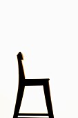 Side view of empty wooden chair on white background