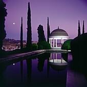 Night view of the ´Mirador de Echevarria-Echevarrieta´ reflection in pond, the bottom view of Malaga  Historical Botanical Garden ´La Concepción´ Malaga, Andalusia, Spain, Europe