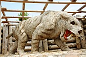 Smilodon fatalis saber-toothed cat in Leba Park dinosaur theme park, Poland