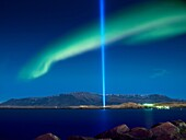 Imagine Peace tower with Aurora Borealis The Imagine Peace Tower, a memorial to John Lennon from Yoko Ono, located on Videy Island, Reykjavik, Iceland  It consists of a tall ´tower of light´, projected from a white stone well which has the words ´Imagine.
