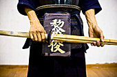 Man Holding Bamboo Weapon