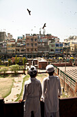 Two Boys Looking at Urban Landscape, Old Delhi, India