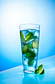 Tall Blue Drink With Peppermint, Lime and Ice